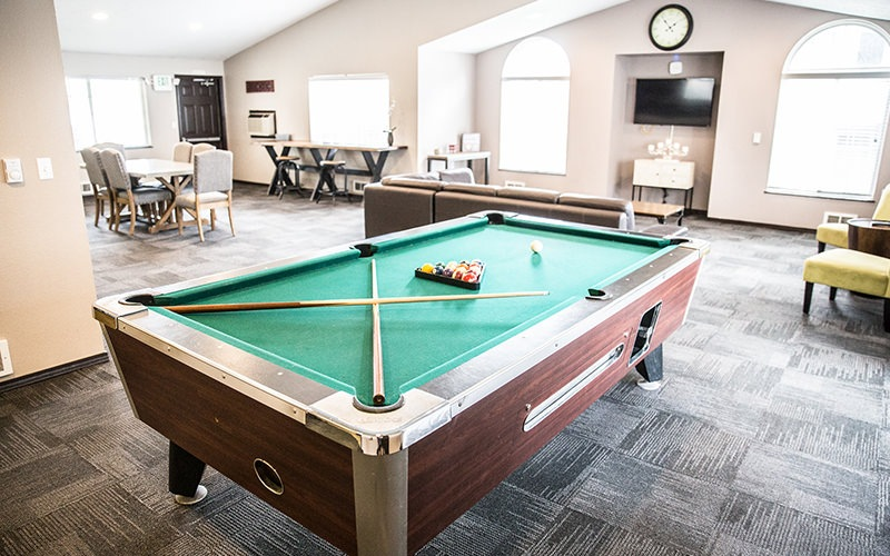 game room with billiards table and couch
